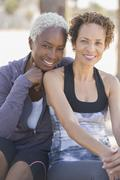 Portrait of smiling lesbian couple outdoors Stock Photos