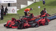 Crew Members Sorting Life Jackets at the Annual Dragon Boat Race, Ontario 2015 Stock Footage