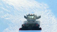 Snow groomer, piste basher cleaning skiing run, winter Olympics - stock footage
