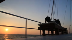 Man relaxing on boat at sunset Stock Footage