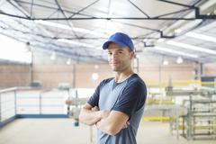 Portrait of confident worker in food processing plant - stock photo