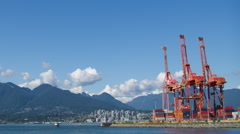 Industrial cranes at the Port of Vancouver on the waterfront time lapse Stock Footage