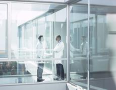 Doctor and administrator talking in hospital corridor Stock Photos