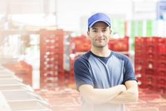 Portrait of worker in food processing plant - stock photo