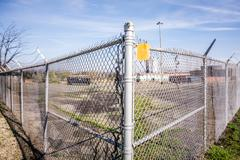 Chainlink fence securing perimeter of property Stock Photos