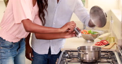 Pretty couple smiling and cooking Stock Footage