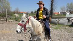 Cowboy Man rides horse on riding course lessons. 4k uhd steadycam stock foota Stock Footage