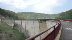 Engineer walking over dam arc crawn pov. Structure security checkup. UHD 4K s Stock Footage