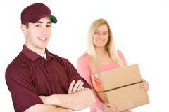 Stock Photo of Shipping: Trustworthy Delivery Man With Customer Behind