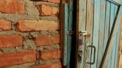 Old Wooden Door & Open Padlock Stock Footage