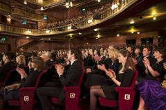 Audience applauding in theater - stock photo