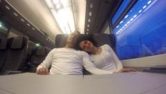 Happy romantic couple on commuter train traveling fast at night. UHD 4K stock Stock Footage
