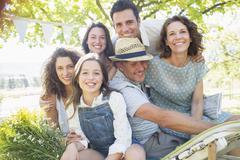 Family hugging outdoors at picnic - stock photo