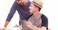 Homosexual couple using tablet Stock Footage