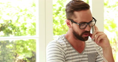 Hipster using computer and phoning Arkistovideo
