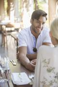 Couple talking in restaurant Stock Photos