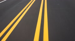 4K Driving Road Yellow Lines Converge Close Up Stock Footage
