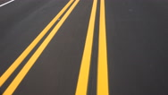 Stock Video Footage of 4K Driving Road Yellow Lines Converge Close Up