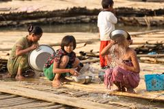 Burmese women in a slum Stock Photos
