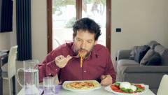 Man with typical mediterranean diet spaghetti mozzarella and tomatoe Stock Footage