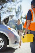 Roadside mechanic arriving to help woman Stock Photos