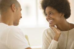 Couple talking indoors Stock Photos