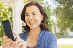 Woman text messaging with cell phone Stock Photos