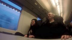 Midaged ouple on fast moving train at night. UHD 4K stock footage Stock Footage