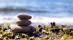 Close up of Stack of Zen stones on beach, HD footage - stock footage