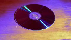 Stylized DVD disc slides into view Stock Footage