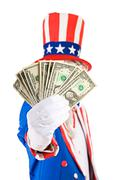 USA: Uncle Sam Holds Out Money Fan Stock Photos