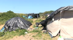 Camp of migrants in Calais. Tents. Stock Footage