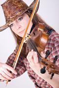 Country girl with cowboy hat plays the viola Stock Photos