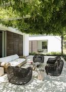 Armchairs and sofa on luxury patio - stock photo