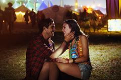 Affectionate couple outside music festival Stock Photos