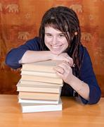 girl with books at desk - stock photo