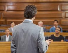 Stock Photo of Lawyer pleading case to jury in court
