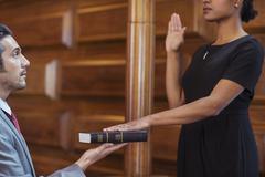 Bailiff giving oath to witness - stock photo