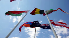 Flags of the countries of the world wave on a wind Stock Footage
