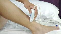 Woman shaving leg in bed suffering pain medium shot Stock Footage
