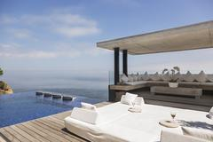 Cabana and infinity pool overlooking ocean Stock Photos