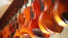 Hanging violin rack focus shot Stock Footage
