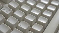 Retro beige PC keyboard keys tilt 4K 2160p UltraHD footage - Slow tilting  on Stock Footage