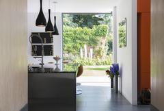 View of garden through modern kitchen window - stock photo