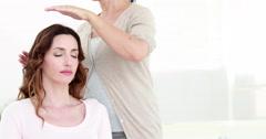 Calm woman receiving reiki treatment Stock Footage
