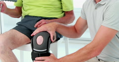 Doctor examining his patient knee Stock Footage