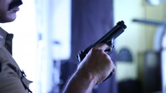 Revolver at police hand - stock footage