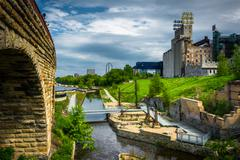 View of Mill Ruins Park and the Stone Arch Bridge in Minneapolis, Minnesota. - stock photo