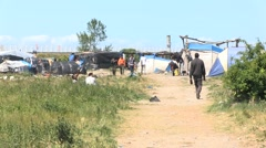 Camp of migrants in Calais, waiting for pass to England Stock Footage