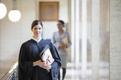 Judge holding legal documents in courthouse Stock Photos